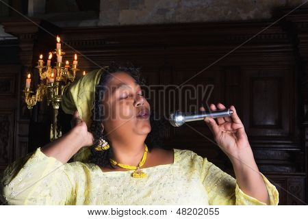 Mature gospel singer with microphone singing during mass