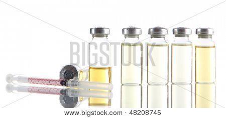 Medical bottle and syringe isolated on white