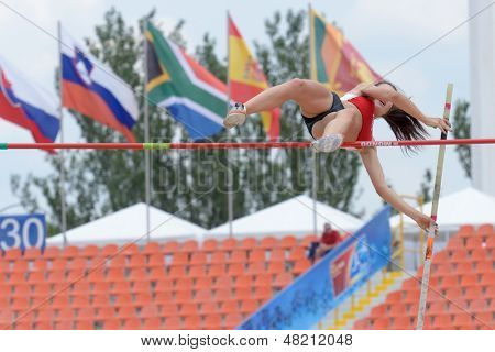 DONETSK, UKRAINE - JULY 11: Krista Obizajeva of Latvia competes in Pole Vault during 8th IAAF World Youth Championships in Donetsk, Ukraine on July 11, 2013