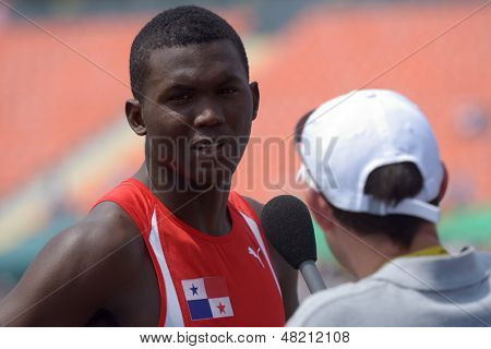 DONETSK, UKRAINE - JULY 12: Arturo Deliser of Panama talk with press after the heat in 200 metres during 8th IAAF World Youth Championships in Donetsk, Ukraine on July 12, 2013
