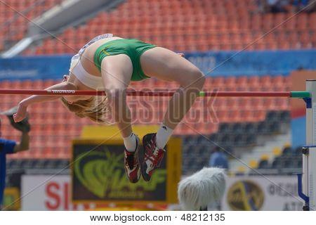DONETSK, UKRAINE - JULY 12: Alysha Burnett of Australia competes in high jump competition in Heptathlon during 8th IAAF World Youth Championships in Donetsk, Ukraine on July 12, 2013