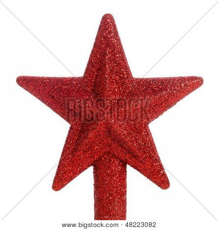 A red glittered star Christmas tree topper
