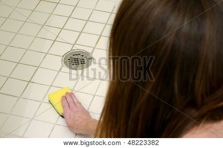 Cleaning Shower With Scour Pad