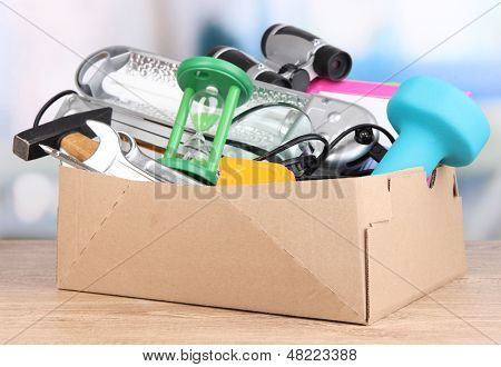 Personal property in carton on table in room