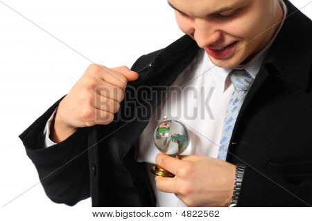 Young Businessman With Glass Globe In Hand