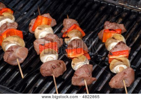 Four Beef Kabobs On A Barbecue Grill