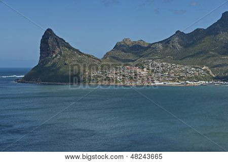 Chapman's Peak Drive. View to part of Hout bay and Hout town. Mountain rock peak.