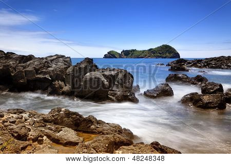 Long exposure image of the rocky coast and the islet of Vila Franca do Campo on Sao Miguel island, Azores