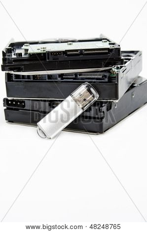 Harddisk and usb drive isolated on white background