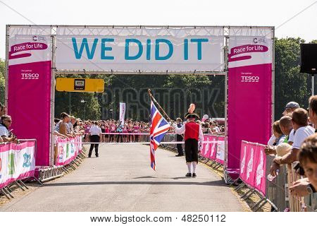SOUTHAMPTON, UK - JULY 14: Town crier starts the annual women's Race for Life to raise money for Cancer Research on July 14, 2013 in Southhampton, UK.
