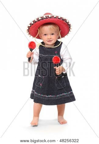 Little girl singing and dancing in the mexican sombrero with
