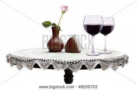 wine glasses with flower on a table