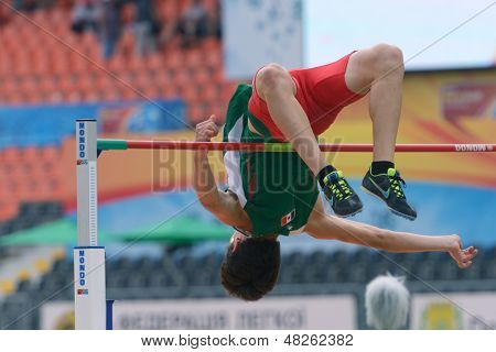 DONETSK, UKRAINE - JULY 11: Luis Andres Casarez of Mexico competes in high jump in Octathlon during 8th IAAF World Youth Championships in Donetsk, Ukraine on July 11, 2013