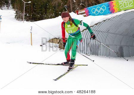 SEEFELD, AUSTRIA - JANUARY 19 Liudmilla Kiaura of team Belarus places 10th in the mixed biathlon relay event on January 19, 2012 in Seefeld, Austria.