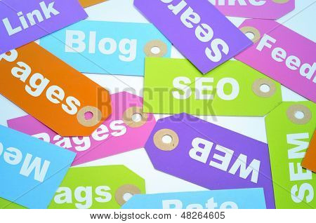 paper labels of different colors with different words about internet marketing and website ranking, such as SEO and SEM, or blog, page, web or link