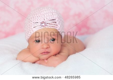 Newborn Baby Girl Wearing A Pink Flapper Style Hat