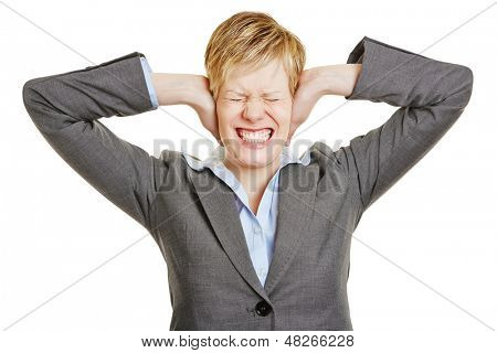 Stressed business woman covering her ears with her hands
