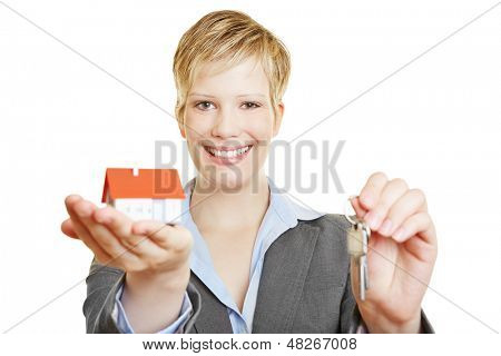 Young business woman with a small house and keys