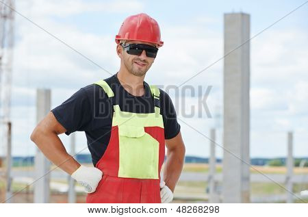 One smiling happy construction site manager worker at building area