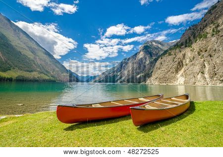 Mountain lake and boats. Seton Lake in Lillooet, Vancouver, Canada. Beauty world.