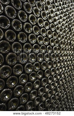 Full frame shot of bottles in wine cellar