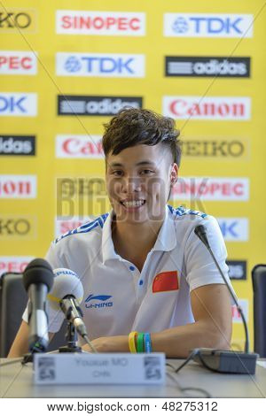 DONETSK, UKRAINE - JULY 12: Youxue Mo of China on the press conference during 8th IAAF World Youth Championships in Donetsk, Ukraine on July 12, 2013