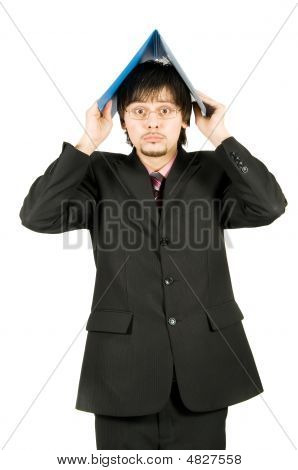 Scared Businessman Holding A Folder Above His Head