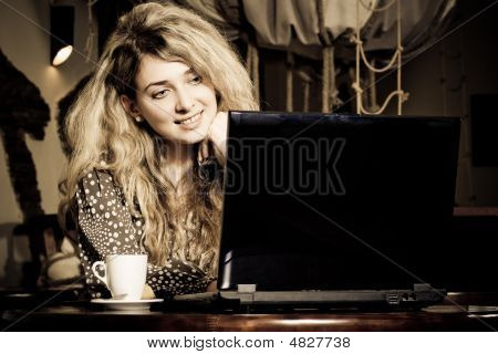 Beautiful Young Woman In Cafe With Laptop And Mobile Phone