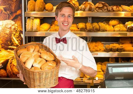 Baker With Basket Full Of Bread In A Bakery