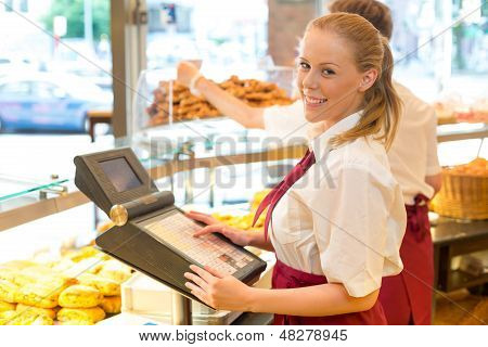 Cashier In Baker's Shop Posing With Cash Register
