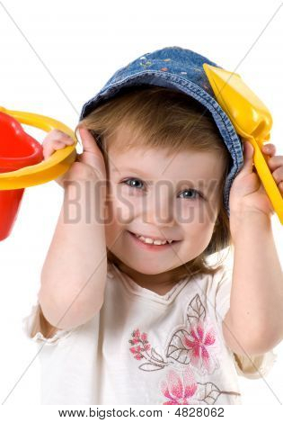Cute Girl With Shovel And Bucket