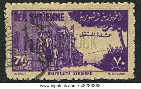 SYRIA - CIRCA 1955: A stamp printed in Syria shows image of The University of Damascus is the largest and oldest university in Syria, located in the capital Damascus, circa 1955.