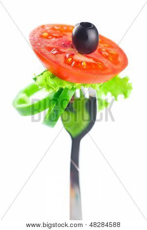 Fork,black Olive,lettuce, Tomato And Pepper Isolated On White