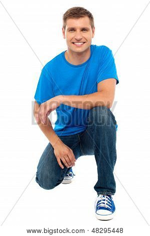 Casual Cool Young Guy Semi Seated On Floor