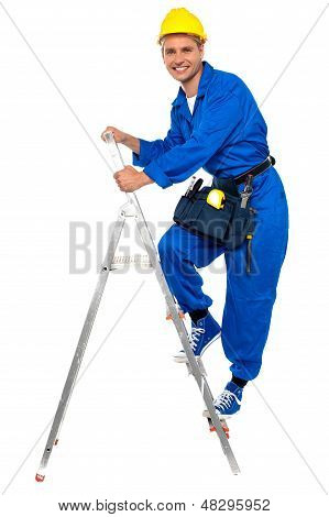 Repairman Climbing Up A Stepladder