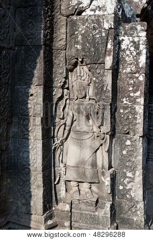 The bas-relief depicting a woman.