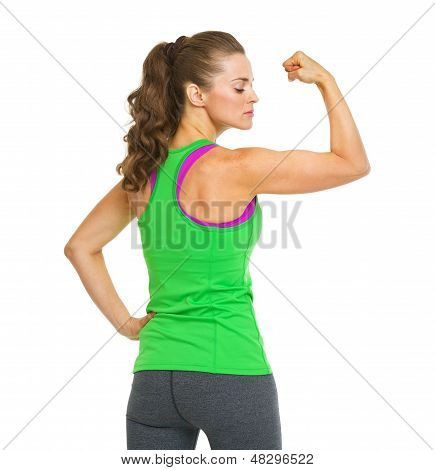 Portrait Of Female Athlete Showing Biceps