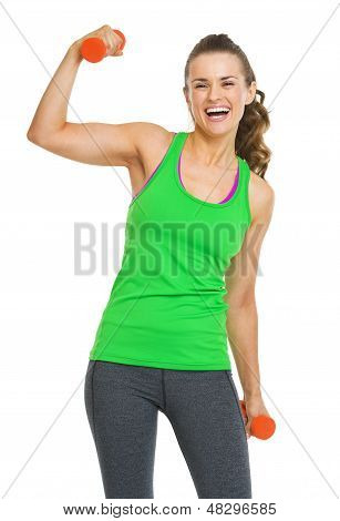 Happy Fitness Young Woman With Dumbbells Showing Biceps