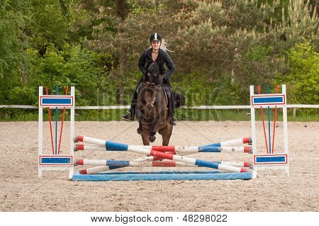 Girl Is Show Jumping With Her Horse