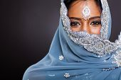 picture of sari  - young indian woman in sari with her face covered on black background - JPG