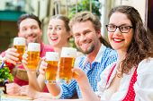 image of lederhosen  - Friends in traditional Bavarian Tracht in restaurant or pub with beer in Bavaria - JPG