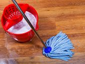 image of bucket  - blue mop and red bucket on wet floor - JPG