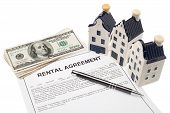 image of rental agreement  - House with rental agreement and cash