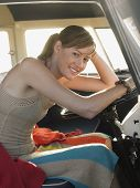 stock photo of campervan  - Portrait of beautiful young woman sitting at driver - JPG