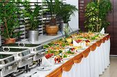 picture of chafing  - banquet table with chafing dish heaters and canapes - JPG
