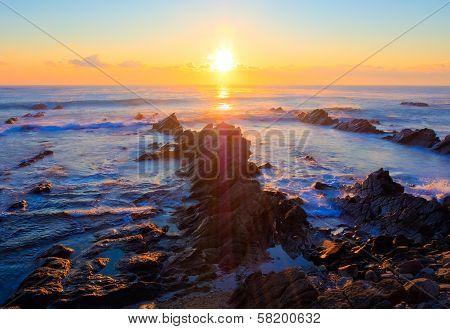 Sunrise over the sea - cretaceous sedimentary rocks