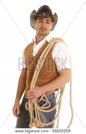 Cowboy In Vest With Rope On Shoulder
