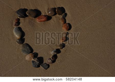 Heart of stones on beach