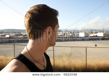 Young Man In Front Of  Pollution