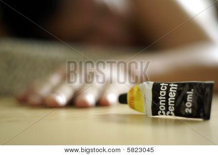 Male glue sniffer on floor